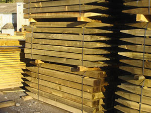 Image of fence posts prepped for delivery